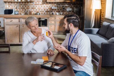 volunteer talking to senior man